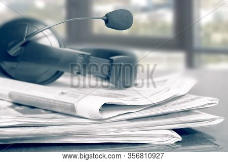 News Newspapers, Voip Headset On The Desktop In The Office, Media Concept, Soft Focus