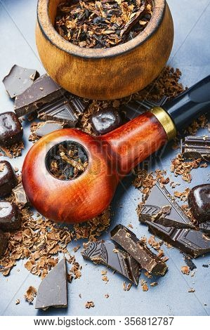 Smoking Pipe With Chocolate Tobacco.