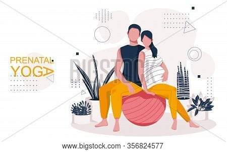 Young Expecting Parents In A Yoga Class For Pregnant Women. A Man And A Pregnant Woman Sitting In A