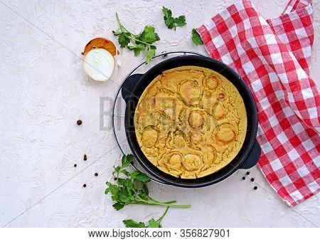 Chickpea Ligurian Farinata, A Chickpea Tortilla With Onions In A Cast-iron Portioned Pan On A Light