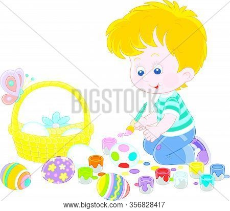 Happy Little Boy Getting Ready For The Holiday, Coloring And Decorating Easter Eggs With A Paintbrus