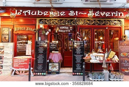 Paris, France-march 12, 2020 : The Traditional French Restaurant Auberge Saint Severin Located Near