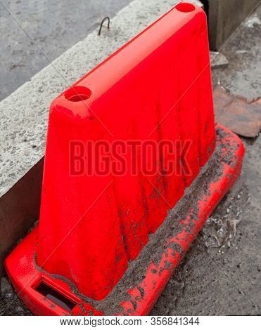 Red Safety Barrier On The Road. Road Construction. Roadwork.