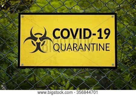Covid-19 Quarantine Fence Warning Sign. Coronavirus, Social Distancing And Self Quarantine Concept.