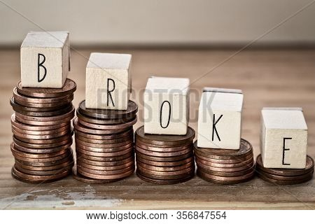 Wooden Cubes With The Word Broke And Pile Of Coins, Money Climbing Stairs, Business Concept
