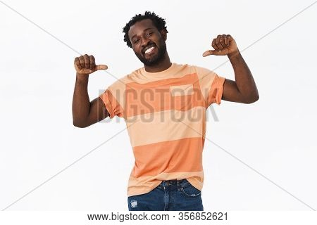 Confident, Cheeky Young Musculine Bearded African-american Guy In Striped T-shirt Looking Manly Prou