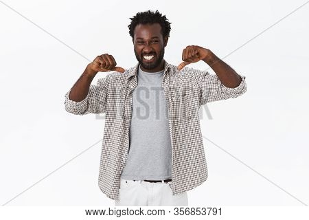 Cheerful Lucky Guy Telling He Won Prize, Pointing Himself And Bragging As Laughing And Smiling Proud