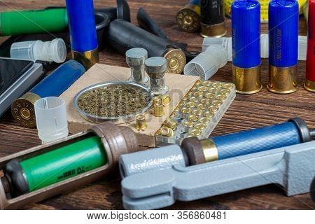 Reloading Process Shotgun Shells With Special Reload Equipment. Powder, Bullets, Fraction, Shells, B
