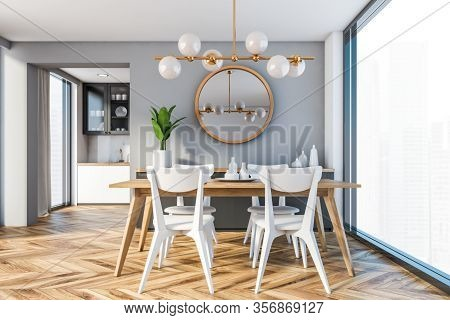 Interior Of Modern Dining Room With Grey Walls, Wooden Floor, Panoramic Window With Blurry Cityscape