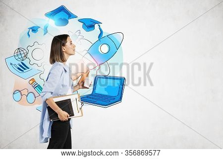 Young College Girl With Long Fair Hair, Coffee To Go And Notebooks Walking Near Colorful Education S