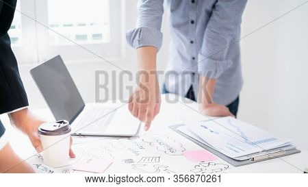 The Man In The White Shirt Point Finger To The Sticky Note On The Table While Do Brainstorm With Col