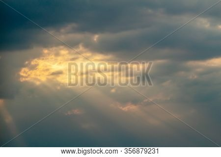 Dramatic Picturesque Colorful Skies With Cloud And Picturesque Sunbeams Before Sunset