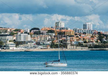 Pleasure Vessel In Cascais Bay With Estoril In Background, Portugal