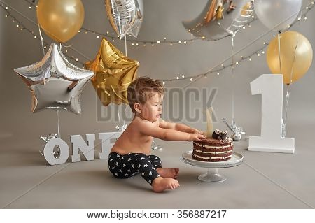 Smash Cake Party. Little Cheerful Birthday Boy With First Cake. Happy Infant Baby Celebrating His Fi