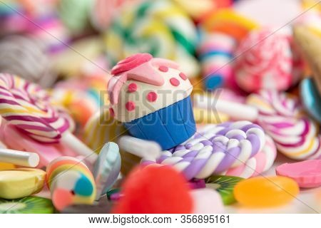 Toys. Cake and different colored round candy. Candy background
