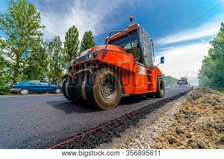 Tandem Vibration Roller Compactor Working On Asphalt Pavement, Selective Focus On Road Repair.