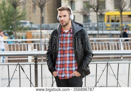 Deliver Perfect Audio Reproduction. Young Man Wear Audio Headphones Outdoor. Handsome Guy Listen To