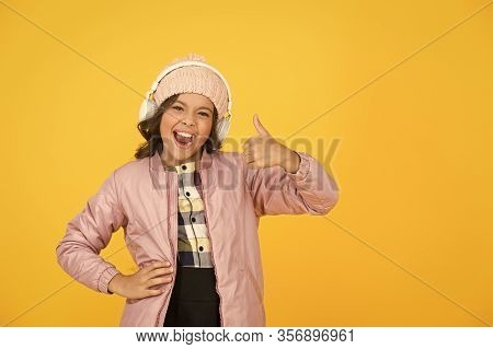 Thumbs Up If You Like This Song. Happy Child Listen To Song Yellow Background. Little Girl Enjoy Son