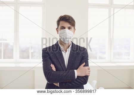 Danger Of Infection Of The Virus Coronavirus Infection. Businessman In Medical Mask At Office