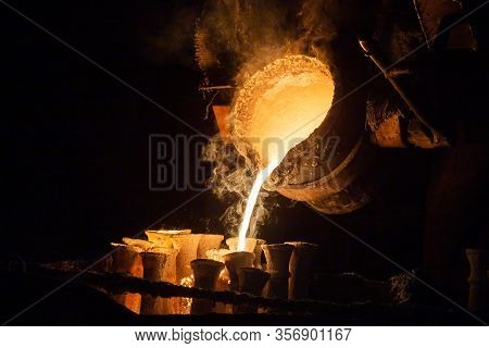 Industrial Lost Wax Casting. The Process Of Pouring For Filling Out Ceramic Shells With Molten Steel