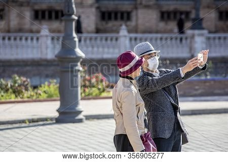 Seville, Spain  - March 7: Unidentified Couple With Man Wearing Mask To Protect Himself And Others F