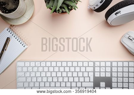 Flat Lay Or Top View Office Table Desk. Workspace With Blank, Keyboard, Pen, Green Plant Succulent,