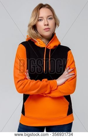 Woman In Black And Orange Hoodie, Mockup For Logo Or Branding Design