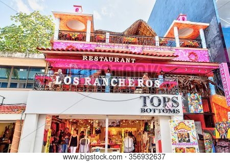 Playa Del Carmen, Mexico - Dec. 26, 2019: Visitors Enjoy Shopping And Dining On Famous 5th Avenue In