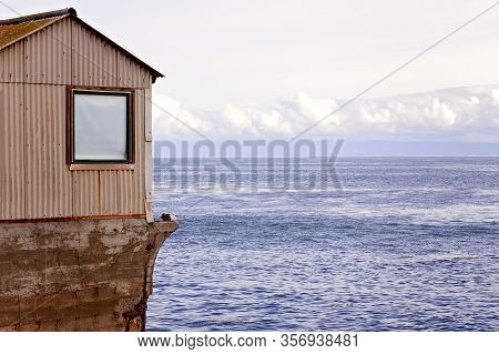 View Of Building On Cannery Row, With Ocean And Clouds, At Monterey, California, Usa
