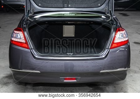 Novosibirsk, Russia - January  31, 2020:  Nissan Teana, Rear View Of A Car With An Open Trunk. Exter