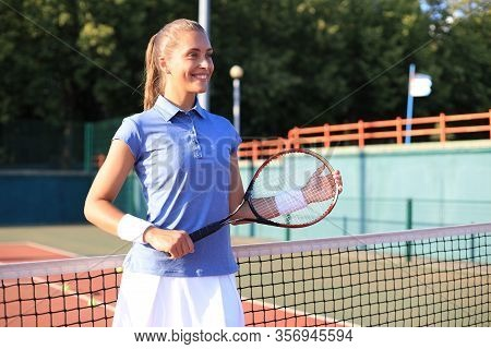 Pretty Sportswoman With Racquet At The Tennis Court. Healthy Lifestyle.