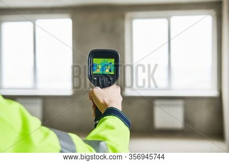 thermal imaging camera inspection of window building. check heat loss