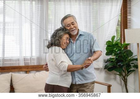 Asian Couple Grandparent Dancing And Hugging Together With Happy Feeling In House, Romantic And Love