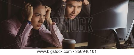 Banner,web Page Or Cover Of Asian Businesswoman And Businessman Working Hard Late Together In Office