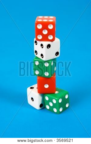 Stack Of Gaming Dice On Blue Background
