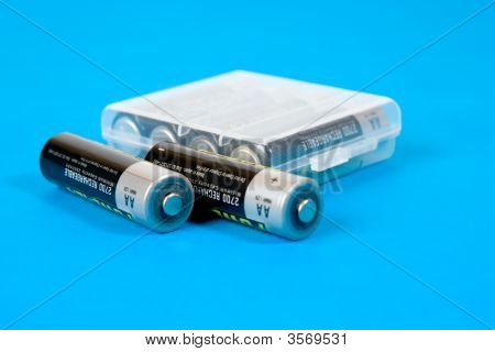 Rechargeable Batteries On Blue Background