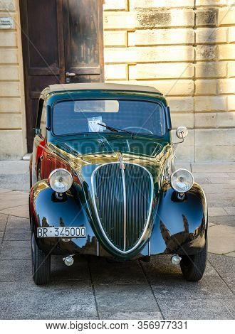 Lecce, Italy - April 23, 2016: Front View Of Vintage Classic Retro Black Automobile Car Parked In A