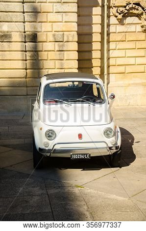 Lecce, Italy - April 23, 2016: Front View Of Vintage Classic Retro White Automobile Car Parked In A