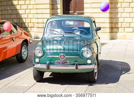 Lecce, Italy - April 23, 2016: Front View Of Vintage Classic Retro Green Automobile Car Parked In A