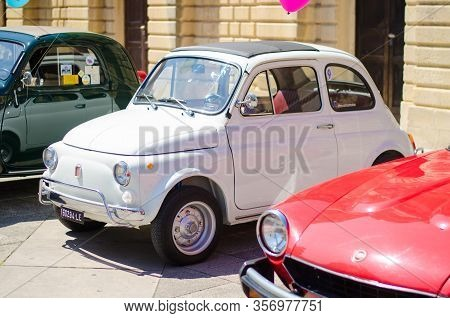 Lecce, Italy - April 23, 2016: Front Right Side View Of Vintage Classic Retro White Automobile Car P