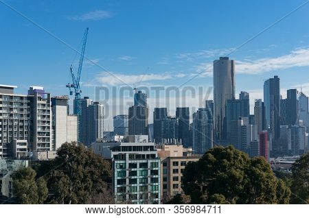 Modern Urban Cityscape With Skyscrapers, Highrise Buildings And Construction Cranes. Urban Developme