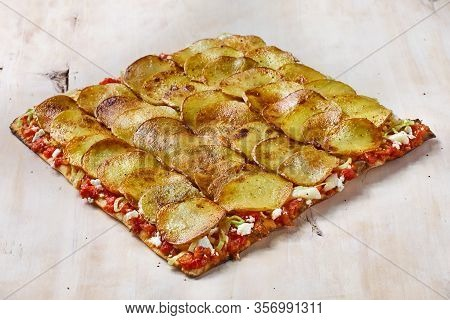 Tart Flambe Or Flammkuchen On Wooden Cutting Board, Traditional Alsatian Pie, Rustic Style, Top View