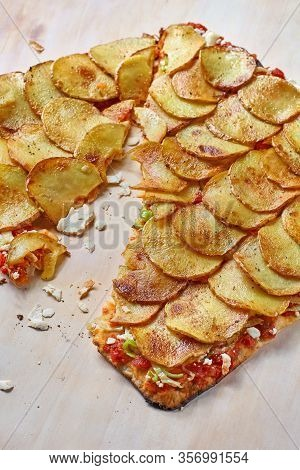Tart Flambe Or Flammkuchen On Wooden Cutting Board, Traditional Alsatian Pie, Rustic Style.