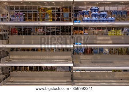 Brugg, Aargau, Switzerland, March 21, 2020: Empty Shopping Shelves In A Coop Supermarket. Customers