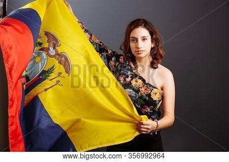 Ethnic Ecuadorian Lady With The Waving Ecuador Flag Isolated On Gray Background