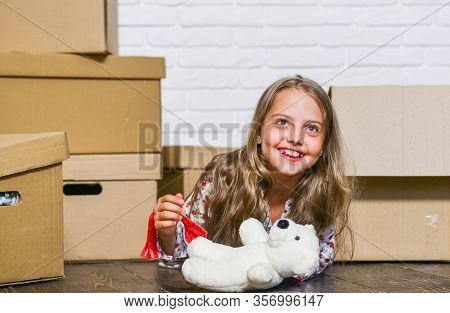 Dreaming About Own Room. Girl Small Child And Boxes. Move Out Concept. Kid Moving Out. Moving Routin