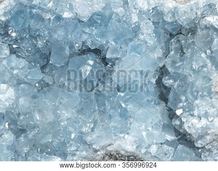 Sparkly Blue Celestite Geode Crystal Background Texture.