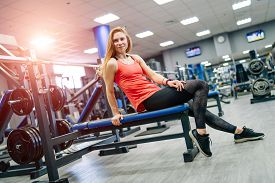 Fit Young Woman After Workout At A Gym. Sport, Fitness, Weightlifting, Bodybuilding, Training, Athle