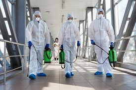 Specialist In Hazmat Suits Cleaning Disinfecting Coronavirus Cells Epidemic, Pandemic Health Risk