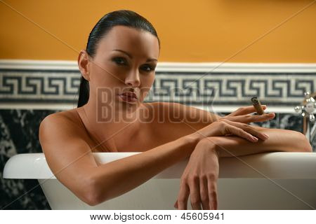 Portrait of sophisticated brunette woman in the bath